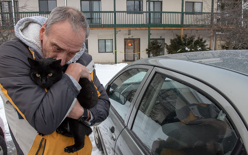 Tim Doucette gives his cat, Q, a kiss before putting him in his car Monday afternoon where he and fellow tennants at 386 Minot Avenue in Auburn were displaced when the roof of the building above his apartment collapsed. Visit sunjournal.com for a video of the scene and Doucette talking about what happened and the obstacles he and fellow tennants face.