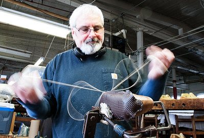 The hands and thread of Bruce Boudreault, a 36 year veteran of hand sewing, are a blur as he crafts a pair of womens' driving moccasins at Quoddy Inc. in the Pepperell Mill on Lisbon Street in Lewiston.(Russ Dillingham/Sun Journal)