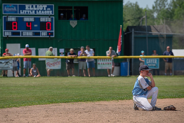 York's Robbie Hanscom tries to keep his composure as he watches a teammate warm up after being releived on the mound during Saturday's championship game in Lewiston where the host team won the game 8-4 and advance to the regional tournament in Connecticut next week.