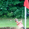 Mia Hornberger blasts out of the sand trap on the second hole of Tuesday's Junior Championship golf tournament at Brunswick Golf Club.  3(Russ Dillingham/Sun Journal)