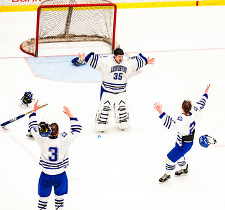 Lewiston's Ryan Bossie, left and Jayden Wilson throw off their helmets as they rush to celebrate with goalie Conrad Albert as time runs out to end the game.  (Russ Dillingham/Sun Journal)