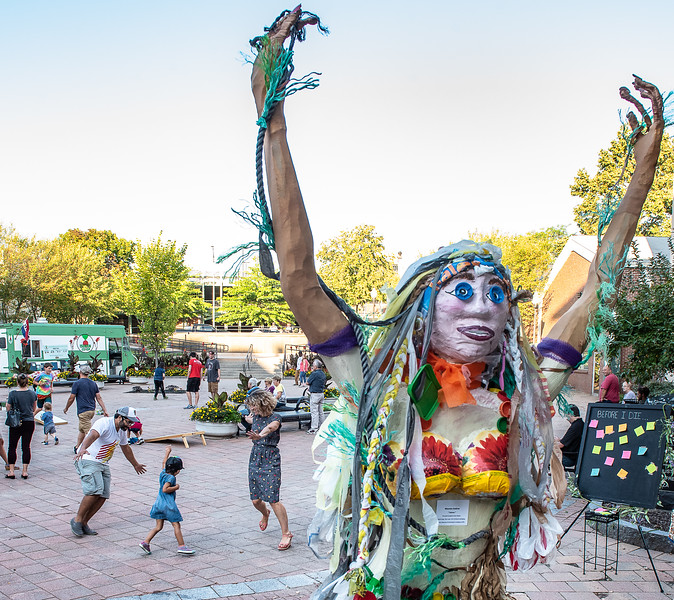 Shaad Masood, left, dances with his daughter Eidie and wife Andrea at Dufresne Plaza in Lewiston to the music of  Sylvain's Acadian Aces during Friday night's Art Walk Lewiston Auburn.  The sculpture in the foreground is by Maureen Andrew of Greene who makes a statement with her artwork by highlighting how much plastic we all use every day that we all need to use less of.