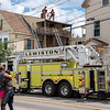 Firefighters quickly extinguished a fire that started in the exhaust fan on the second floor of 71 Walnut Street in Lewiston Monday afternoon, displacing 7 occupants of the downtown apartment building.
