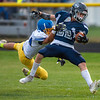 Belfast's Pete Lovejoy, left, manages to drag down Poland's Isaac Fifield after the Poland runner ran up the sideline for a long run during the first half of Friday night's game in Poland.