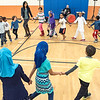 Students from Park Avenue Elementary School in Auburn are joined by teachers, friends and community members in the school's gym to dance to the music of Rabbi Sruli Dresdner, background, during Friday night's annual Multi-Cultural night that featured ethnic food, music, arts, crafts and a miriad of other customs and traditions from countries around the world that represent students heritage.  To watch a video of the dancing, visit sunjournal.com  (Russ Dillingham/Sun Journal)