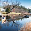 "Rick Speer heads to shore on Lake Auburn near his home on North Auburn Road Friday after a paddle around the lake.  ""I wanted to get one more in during December before I hung it up for the year."" said the retired librarian.  For a shore aerial video of the north end of the lake and the basin, visit sunjournal.com (Russ Dillingham/Sun Journal)"