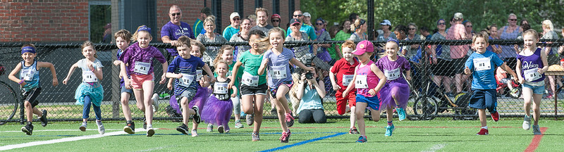 The kids fun run preceded Saturday morning's Safe Voices 5K Walk/Run to End Domestic Violence fundraiser through and around the Bates College Campus.  Safe Voice's mission is to help support and empower those affected by Domestic Violence and engage the community in creating social change in Androscoggin, Oxford, and Franklin counties.<br />    (Russ Dillingham/Sun Journal)