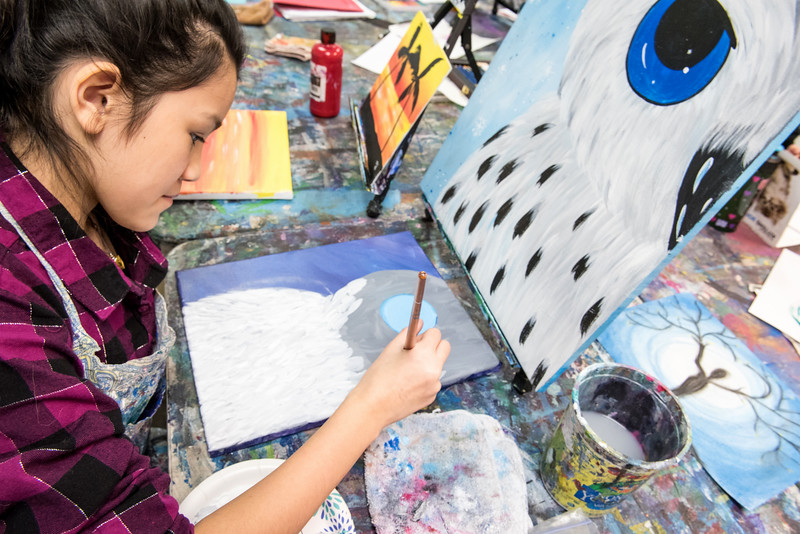 Christina Tancrede, 11, of Lewiston, Maine, works on a painting during her after school art class at Wicked Illustrations Studio and Gallery on Canal Street in Lewiston Wednesday, December 31, 2018. (Russ Dillingham/Sun Journal)