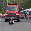 Alex Lynch steers her son Carson's remote control police car at the head of the Wilton Blueberry Festival Parade Saturday morning. Her husband is a Wilton police officer.