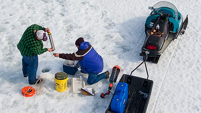 Auburn Water District Treatment Plant Manager Chris Curtis, left and Water Quality Technician Dan Fortin augered through 18-20 inches of ice in one of dozens of spots on Lake Auburn in Auburn, Maine Thursday morning March 21, 2019 while taking phosphorus samples all over the lake to get an idea of the health of the body of water that supplies drinking water to the area.