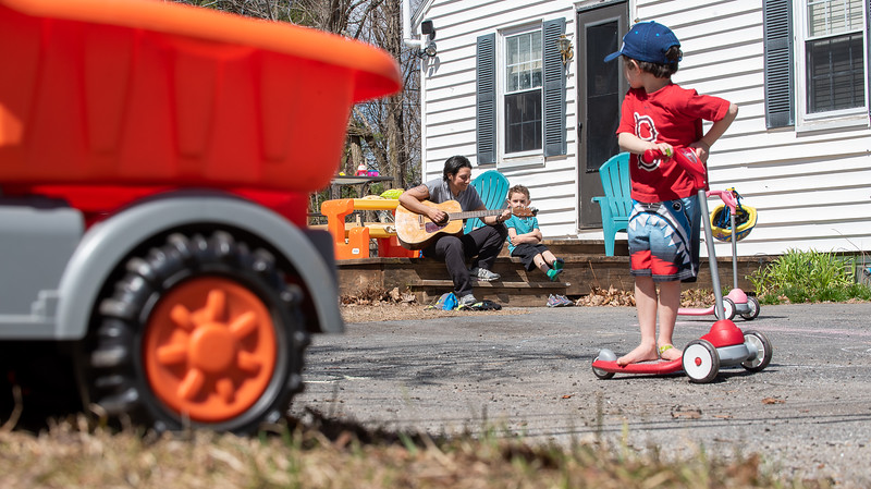 """Stacy Tavares """"conducts a music lesson"""" on the steps of her home in Lisbon Wednesday afternoon with her children, Logan, center and Lexi, right."""