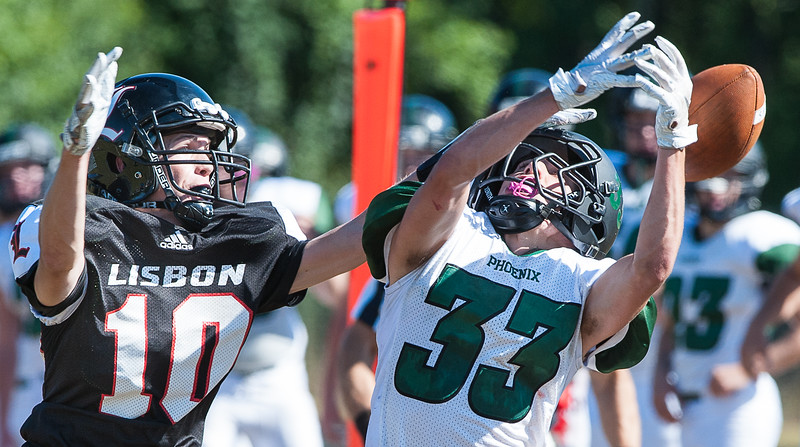 Lisbon't Seth Leeman, left, breaks up a pass intended for Spruce Mountain's Brandon Coates during Saturday's football game in Lisbon. (Russ Dillingham/Sun Journal)