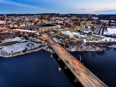 Vehicles streak across the Longley Memorial Bridge as the lights of Lewiston, Maine shine in the background in this aerial time exposure taken on Friday night November 30, 2018.  (Russ Dillingham/Sun Journal Aerial)