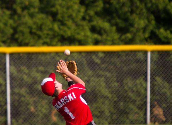 SAM HOUSEHOLDER | THE GOSHEN NEWS Goshen sophomore Michael Pinarski fields a fly ball during the game Friday against Concord.