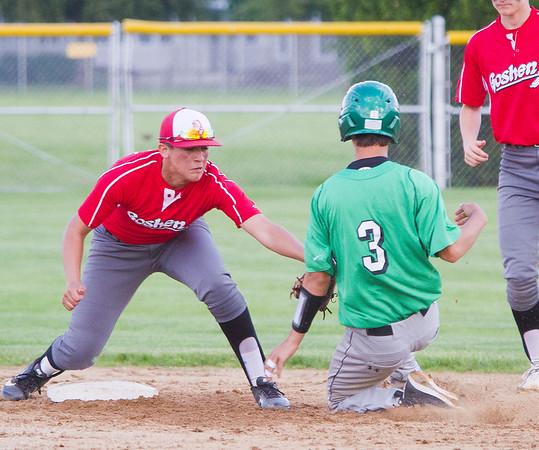 SAM HOUSEHOLDER | THE GOSHEN NEWS Goshen junior Tito Garcia tags out Concord junior Luke Simon during the game Friday.