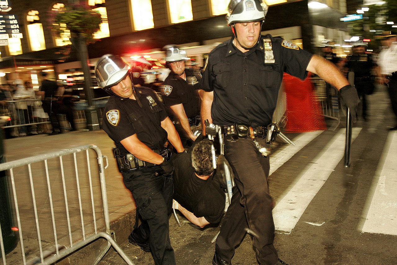8/31/2004 -- New York, NY -- 34th and 6th Ave -- Police dragged off a non-resisting protester on Tuesday evening several blocks from Madison Square Garden, the site of the Republican National Convention. Photo by Dina Rudick, The Boston Globe
