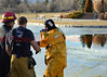 Rescue Crews from CSFD Engine 6 pull a person and a dog from the icy waters at Nancy Lewis Park. December 19, 2013