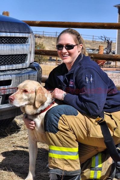 A job well done from Falcon and Colorado Springs Firefighters.  Seen here in this photo, is the rescued dog and Falcon Firefighter Hatzel.  Firefighter Hatzel told me she was pleased to have been part of saving her today.