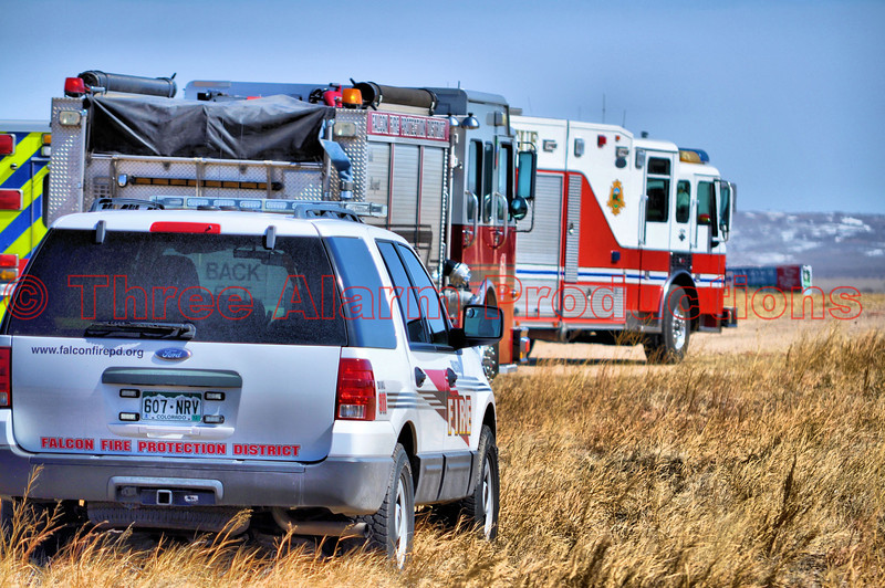 Staging area for the ice rescue, just off of Stapleton Drive in Falcon, Colorado.  In the foreground is Falcon Battalion Chief 303's vehicle.