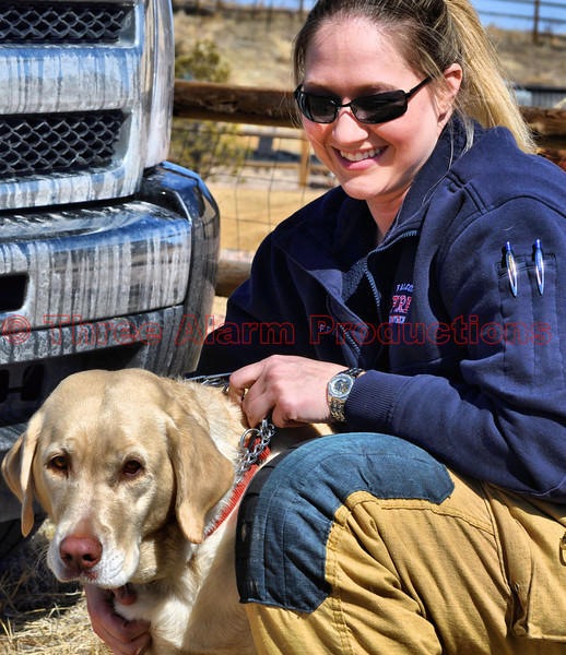 Firefighter Hatzel with the rescued dog.