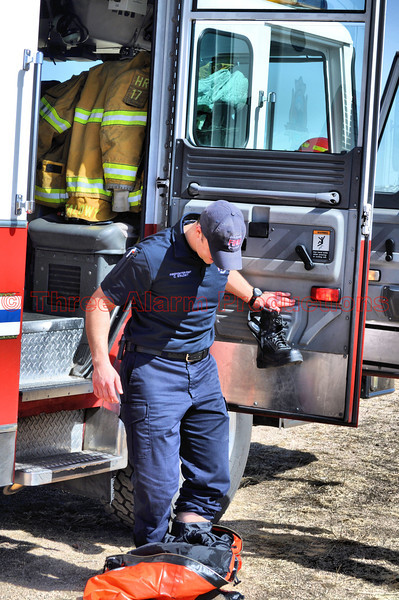 Rescuer Craig Stalowy, with CSFD HR-17, removing his insulated suit.