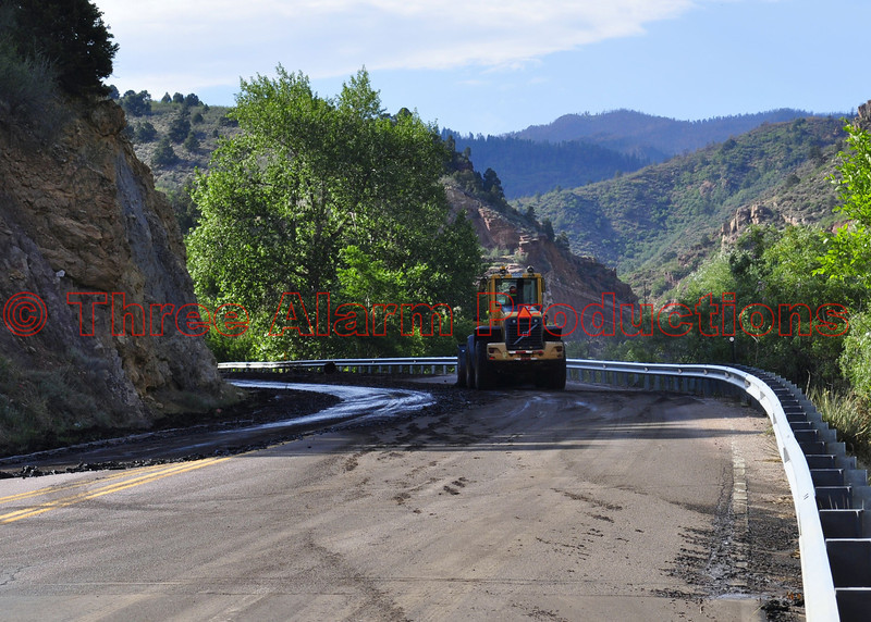 This is looking Northbound Manitou Avenue as Colorado State Highway Workers remove mud and debris from the roadway. Meanwhile, just a ways up on US Highway 24, vehicles were being removed from the sludge and debris mess, in order to re-open the stretch of highway.