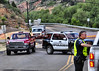 Emergency crews were busy helping trapped motorists on U.S. Highway 24, near Mile Marker 297, due to mudslides coming off the mountains in the Waldo Canyon Burn Scar on the afternoon of July 10, 2013.