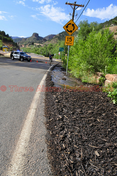 Debris build up along Manitou Avenue near US Highway 24, in Manitou Springs, Colorado, on July 10, 2013, due to a mudslide.