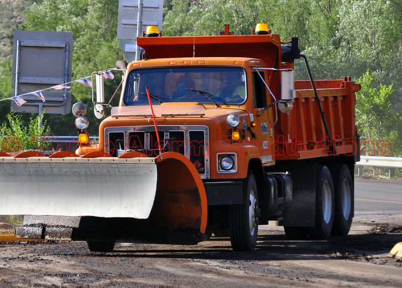 CDOT Plows were dispatched to the scene, to get roadways cleared, as hundreds of commuters waited for the roads to reopen late that evening of July 10, 2013.
