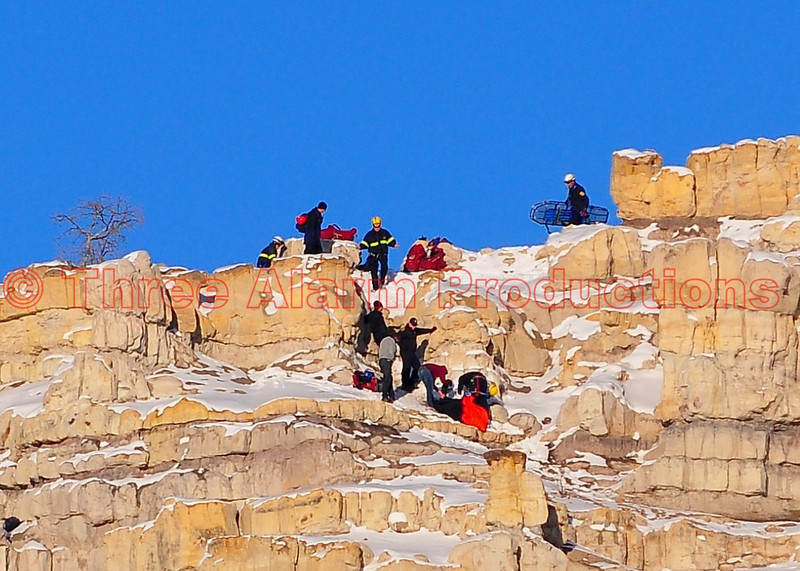 Colorado Springs Firefighters work to prepare an injured hiker for transport, from off the top of Pulpit Rock. December 9, 2013