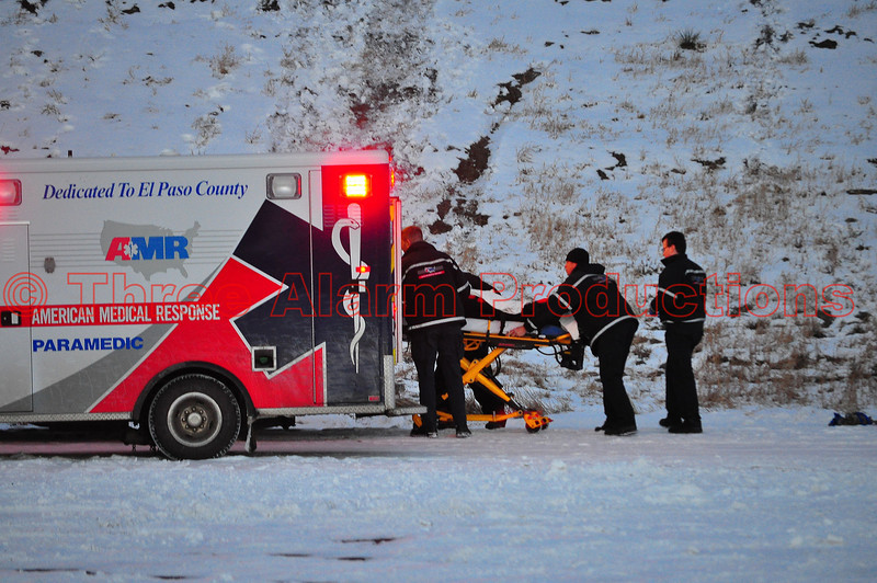 American Medical Response Paramedics loading an injured hiker, after being brought down by CSFD Firefighters from the top of Pulpit Rock.