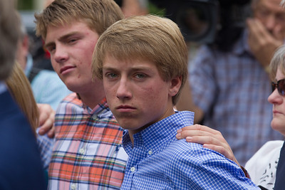Roger Clemens' sons Kacy and Kody stand with their dad as he speaks briefly to the press in front of the E. Barrett Prettyman Federal Courthouse in Washington D.C. at the conclusion of his trial. Roger Clemens was acquitted on Monday, June 18, 2012 on all charges that he obstructed and lied to Congress in denying he used performance-enhancing drugs. (Photo by Jeff Malet)
