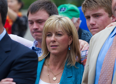Debbie Clemens, wife of Roger Clemens (in tan suit partially hidden on right) is flanked by her sons as her husband speaks briefly to the press in front of the E. Barrett Prettyman Federal Courthouse in Washington D.C. at the conclusion of his trial. Roger Clemens was acquitted on Monday, June 18, 2012 on all charges that he obstructed and lied to Congress in denying he used performance-enhancing drugs. (Photo by Jeff Malet)
