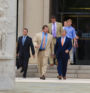 Roger Clemens (center) exits the E. Barrett Prettyman Federal Courthouse in Washington D.C. surrounded by his legal team and family members. Roger Clemens was acquitted on Monday, June 18, 2012 on all charges that he obstructed and lied to Congress in denying he used performance-enhancing drugs. (Photo by Jeff Malet)