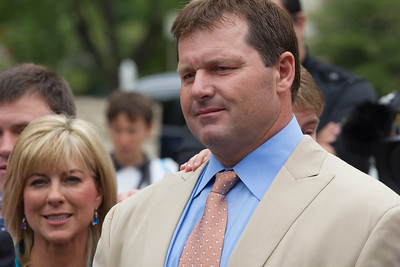 Roger Clemens (in tan suit) is flanked by wife Debbie as he speaks briefly to the press in front of the E. Barrett Prettyman Federal Courthouse in Washington D.C. at the conclusion of his trial. Roger Clemens was acquitted on Monday, June 18, 2012 on all charges that he obstructed and lied to Congress in denying he used performance-enhancing drugs. (Photo by Jeff Malet)