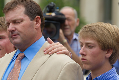 Roger Clemens (in tan suit) is flanked by son Kody as he speaks briefly to the press in front of the E. Barrett Prettyman Federal Courthouse in Washington D.C. at the conclusion of his trial. Roger Clemens was acquitted on Monday, June 18, 2012 on all charges that he obstructed and lied to Congress in denying he used performance-enhancing drugs. (Photo by Jeff Malet)