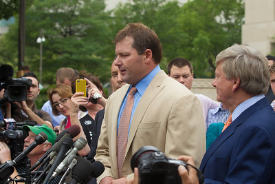Roger Clemens speaks briefly to the press in front of the E. Barrett Prettyman Federal Courthouse in Washington D.C. at the conclusion of his trial. Lead lawyer Rusty Hardin stands on right in photo. Roger Clemens was acquitted on Monday, June 18, 2012 on all charges that he obstructed and lied to Congress in denying he used performance-enhancing drugs. (Photo by Jeff Malet)