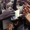 Finding some drinkable water becomes impossible. <br /> The NGO start to distribute dinfectants.<br /> <br /> Rwanda, November 1996.<br /> <br /> © Laura Razzano