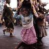 Refugees go on its march, often in the rain.<br /> Rwanda, November 1996.<br /> <br /> © Laura Razzano