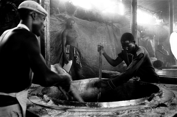In the middle of the yard there are the kitchen, two big tanks are used to cook maize meal.<br /> Rwanda, Prison of Gitarama, November 1996.<br /> © Laura Razzano