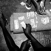 Some of the prisoners spend their time playing cards.<br /> Rwanda, Prison of Gitarama, November 1996.<br /> © Laura Razzanoo