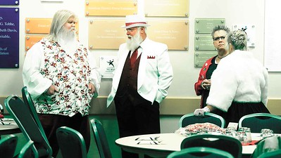 They're not all red suits at the Buckeye Santa School. BRUCE BISHOP/CHRONICLE