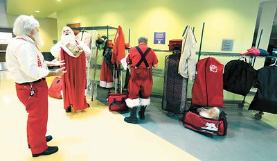 Santas change into their uniforms at the Buckeye Santa School. BRUCE BISHOP/CHRONICLE