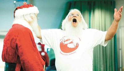 "Dave Allen of Port Clinton belts out a jolly ""ho ho ho"" in Buckeye Santa school. BRUCE BISHOP/CHRONICLE"