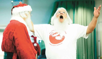"Dave Allen of Port Clinton belts out a jolly ""ho ho ho"" in Buckeye Santa school. BRUCE BISHOP/CHRONICLE"