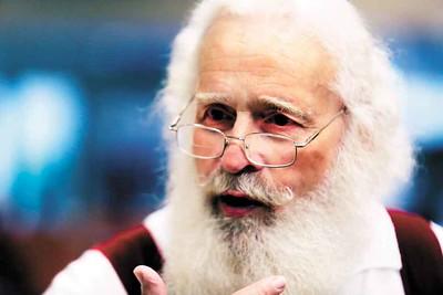Dennis Blandon talks about his experience being Santa at the Buckeye Santa School. BRUCE BISHOP/CHRONICLE