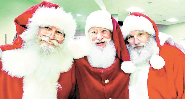 From left, R.J. of Northfield, Tom Shilling of New Philadelphia and Wayne Norris of Columbus pose for a photo at Buckeye Santa School. BRUCE BISHOP/CHRONICLE