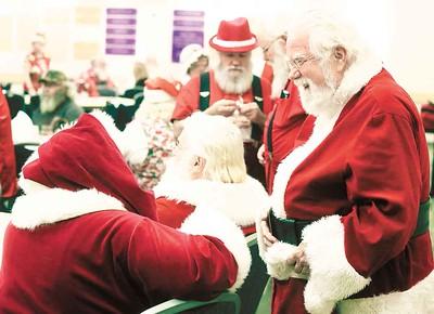 Santas share a laugh at the Buckeye Santa School. BRUCE BISHOP/CHRONICLE