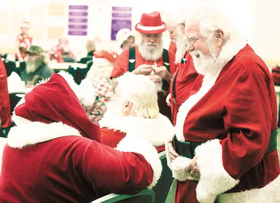 Santas share a laugh at the Buckeye Santa School. BRUCE BISHOP/CHRONICLE