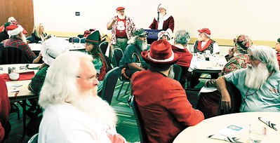 It's not all milk and cookies -- Santas talk insurance at Buckeye Santa School. BRUCE BISHOP/CHRONICLE